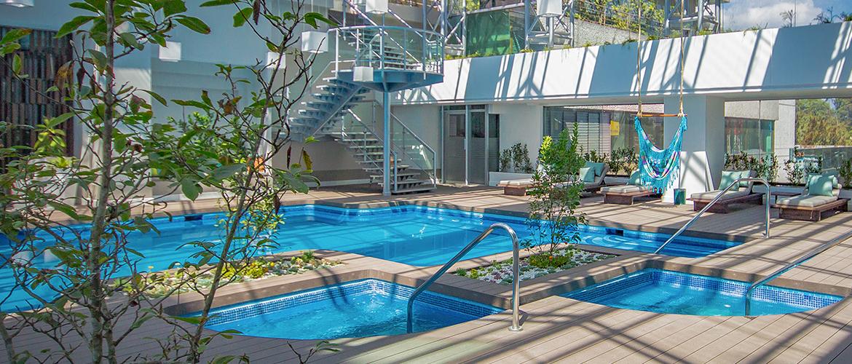 Piscina grand tikal futura hotel for K sol piscinas